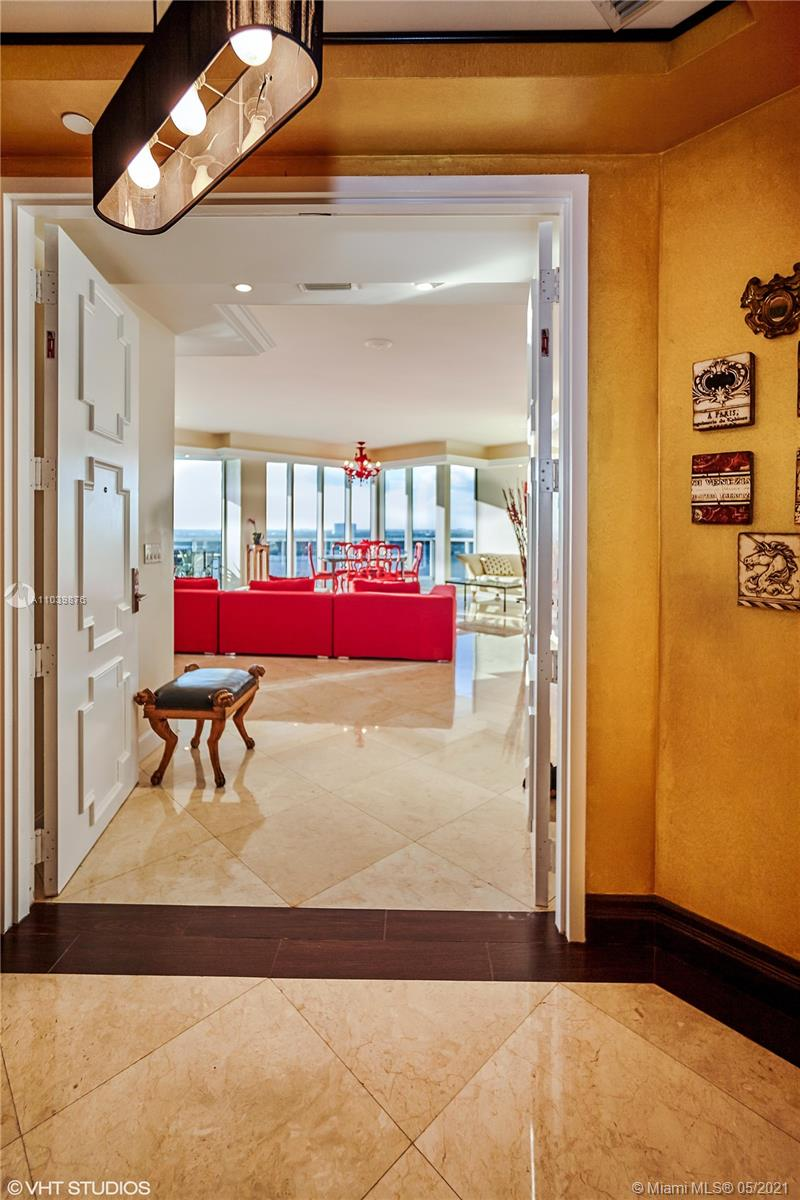 Photo of 10225 Collins Ave #1703, Bal Harbour, Florida, 33154 - Grand entrance to the lobby and reception desk.
