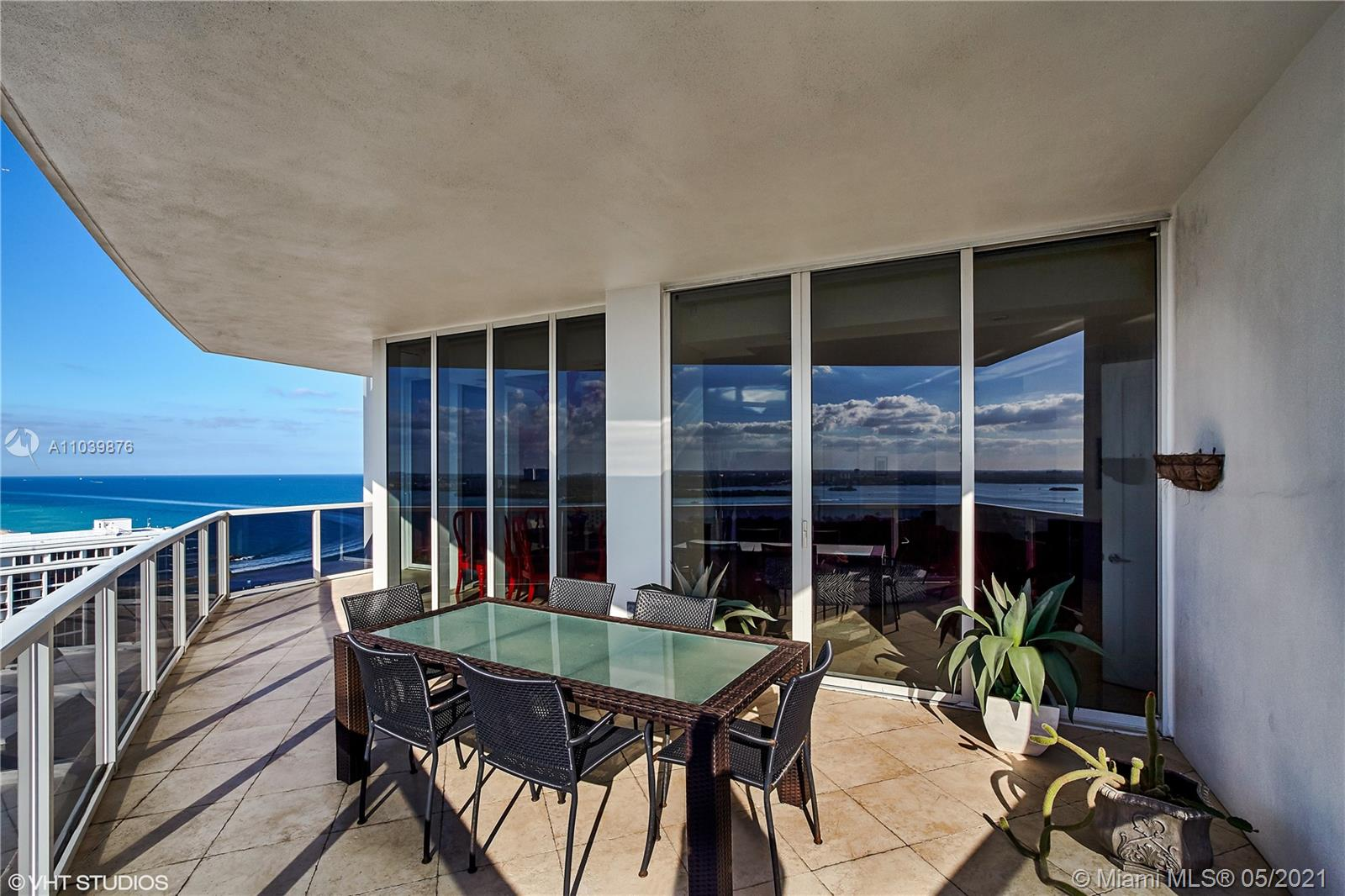 Photo of 10225 Collins Ave #1703, Bal Harbour, Florida, 33154 - Expansive, sun-filled living and dining area.