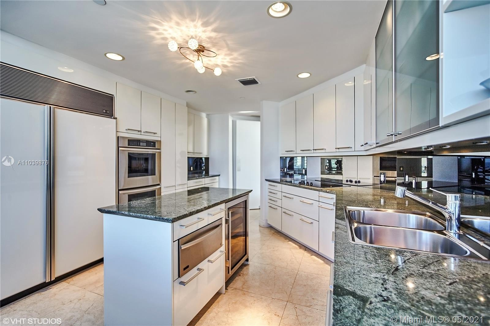 Photo of 10225 Collins Ave #1703, Bal Harbour, Florida, 33154 - Large dine-in kitchen, fully stocked and equipped with refrigerator and freezer, double ovens, built-in microwave, dishwasher and wine refrigerator.
