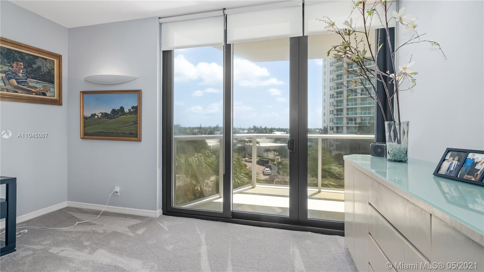 Photo of 20281 Country Club Dr #314, Aventura, Florida, 33180 - Principal Bedroom with built-in wall unit