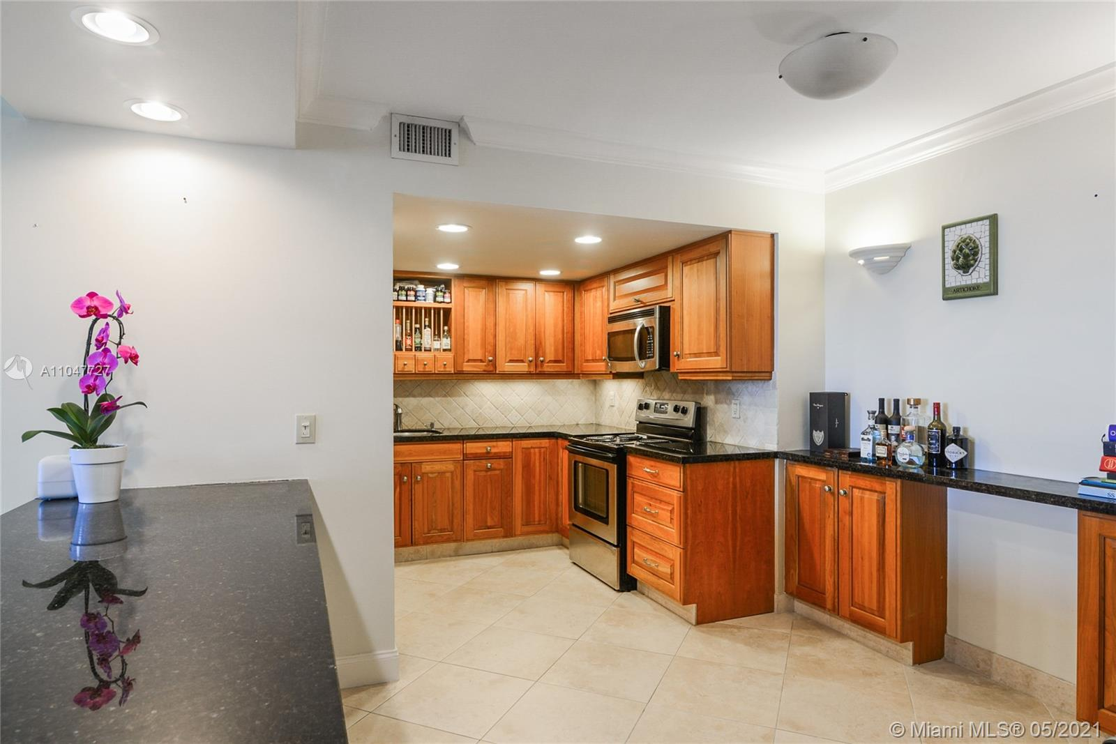 Photo of 9801 Collins Ave #14P, Bal Harbour, Florida, 33154 - Living-room, Open kitchen and entrance door.