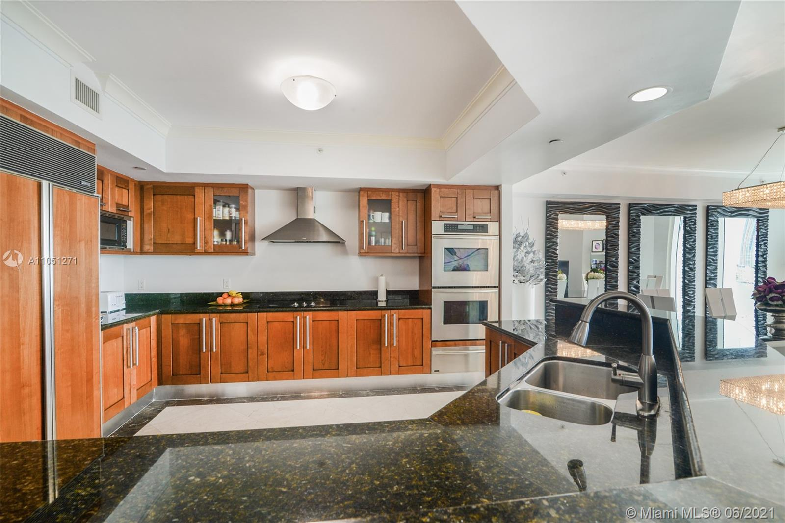 Photo of 3301 183rd St #1906, Aventura, Florida, 33160 - Hall from the Bedrooms to the  Den, Living and kitchen area