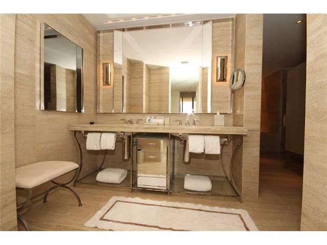 Photo of 9703 COLLINS #1206, Bal Harbour, Florida, 33154 - MASTER CLOSET WALK THROUGH TO SPA RESTROOM